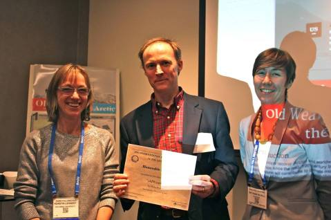Gil Compo (centre) accepts the honourable mention oldWeather was awarded in the The 2013 International Data Rescue Award in the Geosciences, from organisers Kerstin Lehnert (IEDA, left) and Bethan Keall (Elsevier, right).